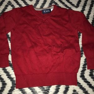 red toddlers sweater
